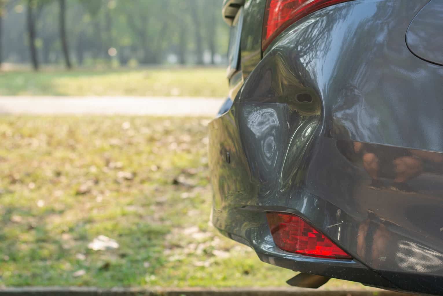 Car a broken rear bumper, The car stopped on road which ...
